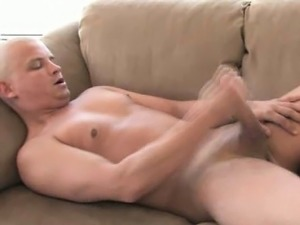 Erotic shaved gay Lance masturbating his enormous cock on