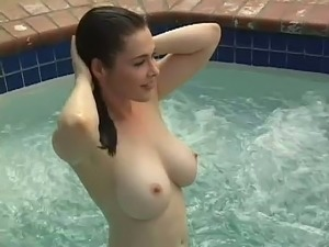 Naked girl in a pool