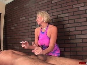 mature woman giving handjob