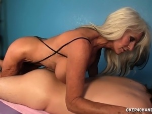Big breasted blonde milf sends her gifted hands pleasing a long prick