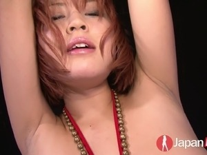 Tied up Japanese chick in red bikini Sara gets her pussy toyed