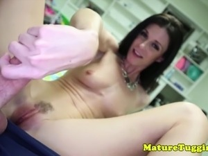 Petite milf jerking cock and sucking balls