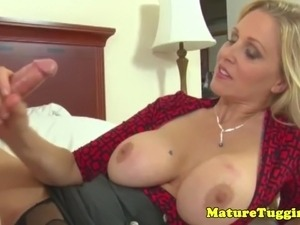 Bigtitted milf jerking on cock