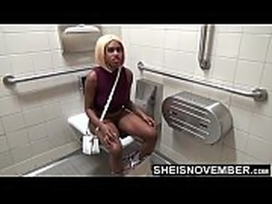 Nude girl in toilet